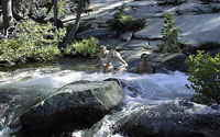 A Cascade River pool cools down these hikers from Lake Village's vacation rental condoiniums.
