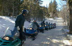 Along the trail there is always a straggler.   Here the  group from Lake Village 's Accommodation Tahoe waits on a straggler.