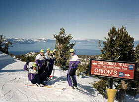 A group of Accommodation Tahoe guests enjoy a sunny day Heavenly Valley Skiing
